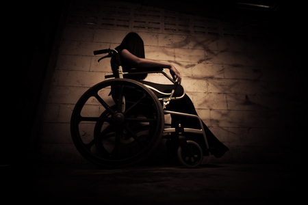Ghost woman sitting on wheelchair in asylum,Scary background for book cover Stock Photo