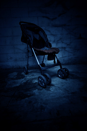 exorcist: An empty baby stroller in haunted house,Scary background for book cover