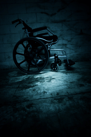 Empty wheelchair in haunted house,Scary background for book cover