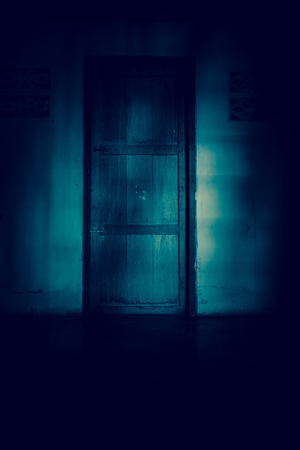 exorcist: The door of haunted house** Note: Slight blurriness Stock Photo