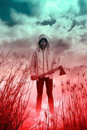 hatchet: Serial killer with hatchet,Scary background for book cover ideas