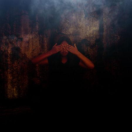 exorcist: Girl sitting in dark place and close her eyes,Horror background for halloween concept and book cover ideas