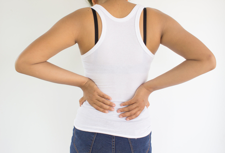 Woman suffering from back pain or spine pain,Woman healthcare concept and ideas Stock Photo