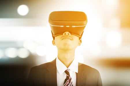 Young businessman wearing virtual reality glasses Stock Photo