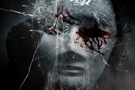 Mysterious woman in black wearing white mask hidden shattered glass ,Scary background for book cover