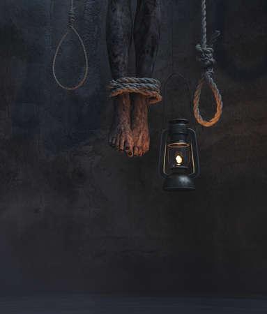 Piernas de cadáver colgando en una habitación oscura con linterna colgante y soga de cuerda, ilustración 3d Foto de archivo