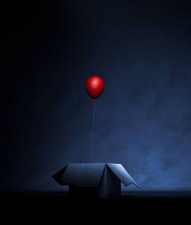 Red balloon in open cardboard box in the dark,3d rendering