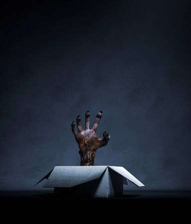 Monster hand in a open cardboard box,3d rendering