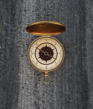 Vintage golden compass on the floor,3d rendering