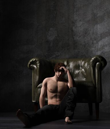 Sexy shirtless man sit leaning on vintage chair,3d rendering,3d figure