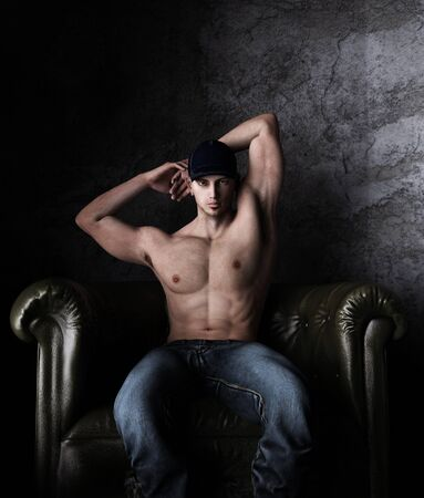 Sexy shirtless man sitting on the vintage chair,3d rendering,3d figure