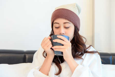 Portrait of a beautiful young lady drinking her morning coffee in her bedroom Stock Photo