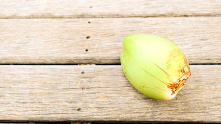 Fresh green young coconut showed on brown wood background