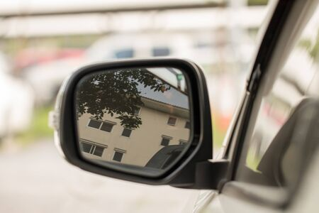 The left side mirror of the car To look at the environment around the car while driving on the road Stok Fotoğraf