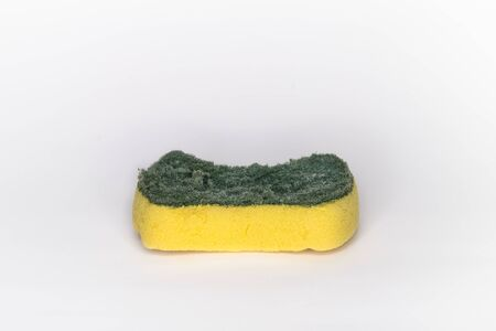 Old sponges for washing dishes and have signs of use. The sponge has two layers. Consists of the top layer are green and the bottom layer is the yellow and white background