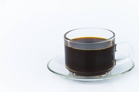 Closeup of black coffee in a clear glass container The image has blank space beside the object and has a white background. The image is partially clear.