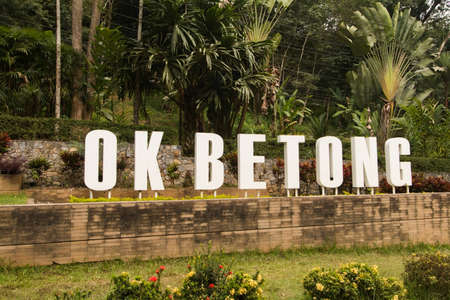 Public signs, OK BETONG messages, entrance signs for Betong District, Yala Province, Thailand