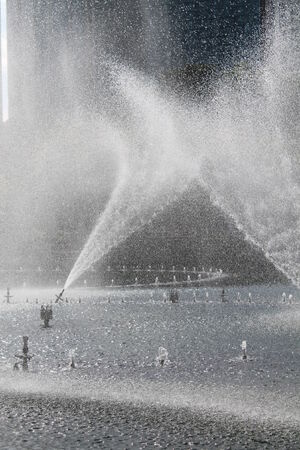 Spray water effect with city background photo