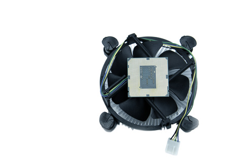 image of a CPU and cooling fan with heatsink  on white background Stock Photo