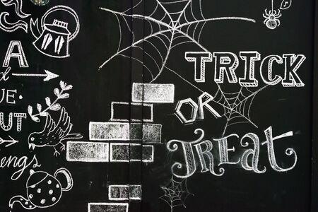 Chalk drawing design on black wall photo