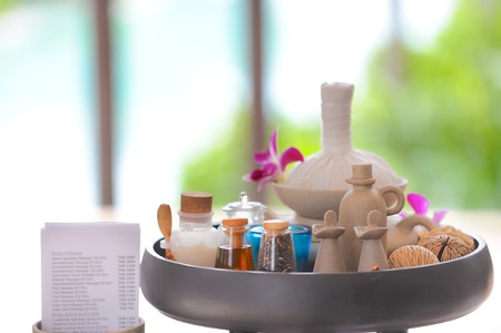 Spa & aromatherapy set including perfumes, oil jar, herbal ball and orchid flowers photo