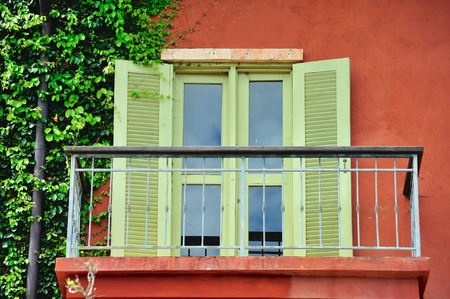 Vintage metal terrace and windows Italian style house photo
