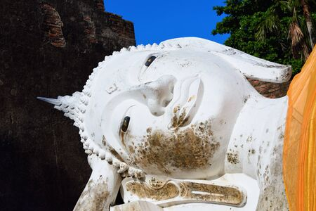 chaimongkol: Reclining Buddha statue closeup at Wat Yai Chaimongkol, Ayutthaya, Thailand Stock Photo
