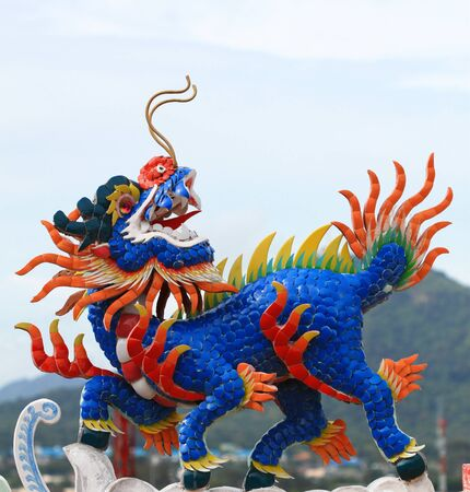 chinesse: Dragon head unicorn stucco on temple roof Stock Photo