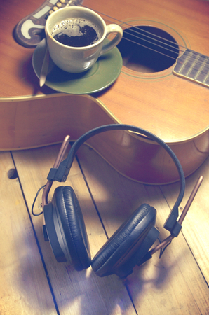 digitals: A cup of coffee, a guitar, headphones Stock Photo