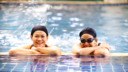 Chainat Thailand , MARCH 29 ,2019 : Two women swimming  in salt pool .They  happy exercise far health care at fantasy resort swimming pool  , Chainat Thailand 報道画像