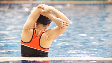 Asia women swimming .She is a happy exercise.