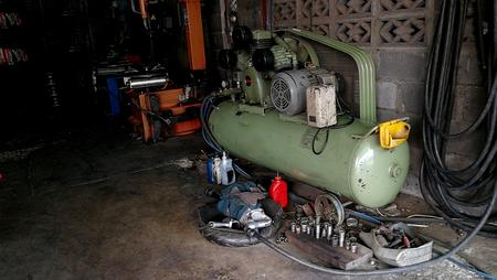 Air pump in car tire repair garage