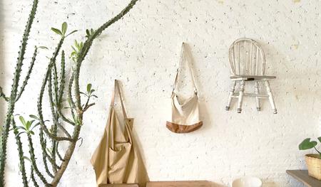 Hand bag vintage wood chairs  hanging decoration white brick wall Zdjęcie Seryjne