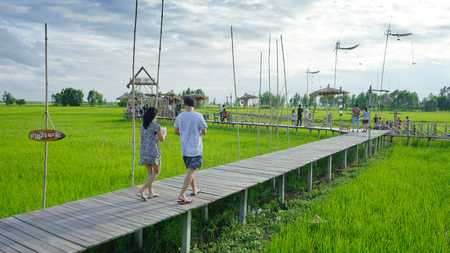 AYUTTAYA, THAILAND - AUGUST, 10, 2019 : THAI tourists at RUKNA CAFE, cafe is landmark of AYUTAYA. THE cafe  is built with bamboo In the middle of the green field. It is popular with tourists.
