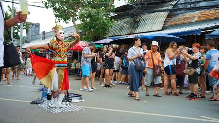 JATUJAK, BANGKOK, THAILAND - AUGUST 10,2019 : THAI pantomime dance art  showing on street of JATUJAUK market . THE market is landmark travel of BANGKOK THAILAND
