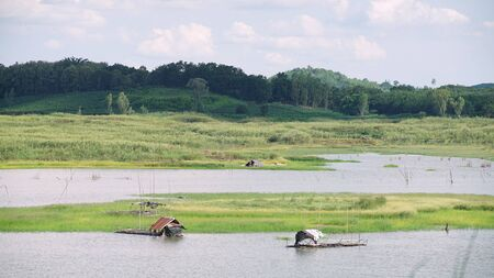 Landscape of Thailand countryside .Hut of fisherman in lake on mountain