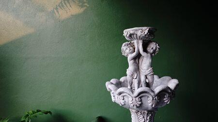 English fountain sculpture in the garden