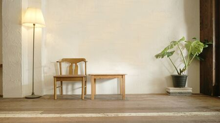 Chairs and table front thw loft white wall .Interior decoration living room background