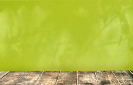 Old top table .Background is green wall blured  mockup background concept . Stock fotó