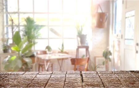 Stone top table indoor .Blur indoor garden background .mockup workspace
