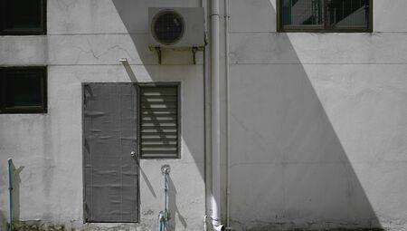 back door of city building in Bangkok .Background street art photo