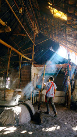 NAN ,Thailand ,11/26/2020;The cultuire and life of Thailand north people  .Villagers are producing rock salt with the method of boiling on a bran style stove ,