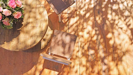 Woodland  in sunrise shade .wood table and wood chairs in sunrise morning background idea concept Stock fotó