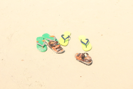 swimming shoes: the people leave shoes on the beach before go to swimming Stock Photo
