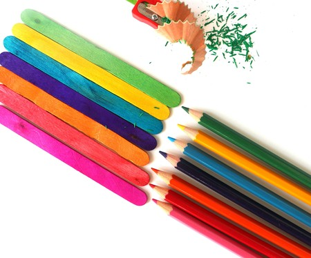 colored pencils: different colored pencils on white background