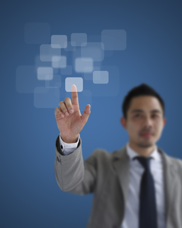 Asia businessman hand pushing business graph on touch screen interface