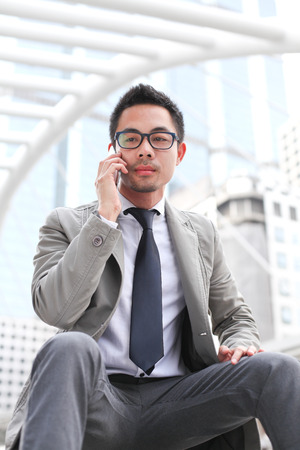 Asia business man talking on smart phone.