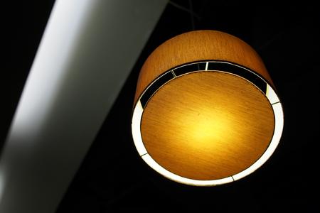Orange light rounded hanging lamp
