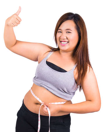 circumference: Obese woman body and measure their waist circumference with a tape measure against on white background
