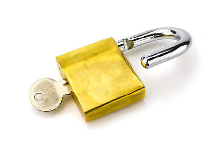 theft prevention: Unlocked padlock with the key on white background